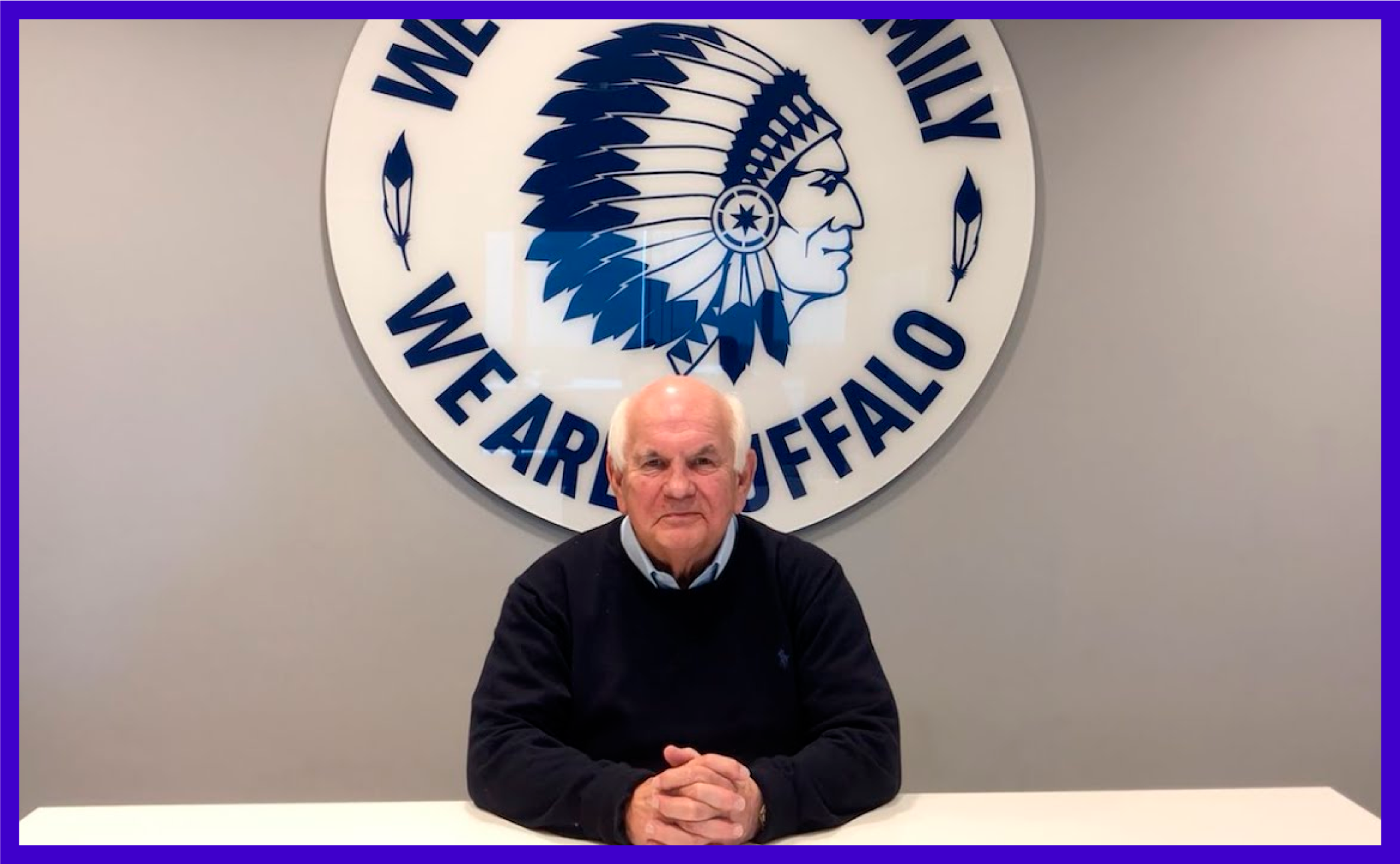 Football club KAA Gent's chairman Ivan De Witte, before We Are One Family, We Are Buffalo sign and KAA Gent logo